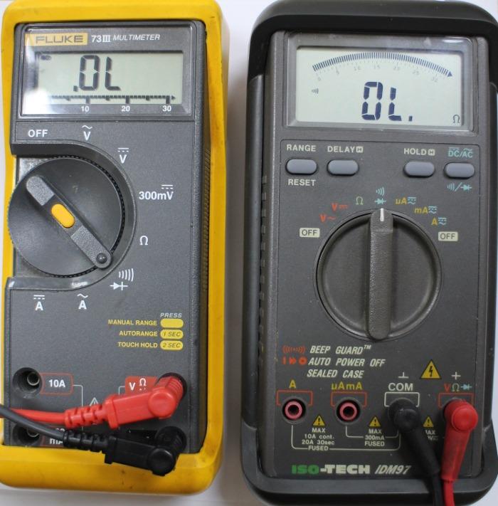Multimeter set to flow of current